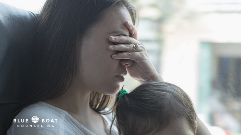 Stressed mom with baby   Blue Boat Counseling can help with anxiety and stress management   therapist columbus ohio